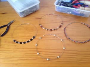 Simple necklaces, beads on one wire, kept n place by crump beads
